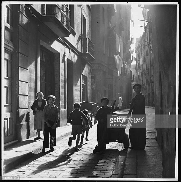 Children play on a street in Barcelona after the General Strike of 1951 | Location Barcelona Spain
