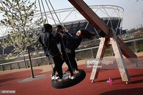 Children play on a swing at the Olympic Park on April 2 2014 in London England The 560 acre Queen Elizabeth Olympic Park complete with 5 Olympic...
