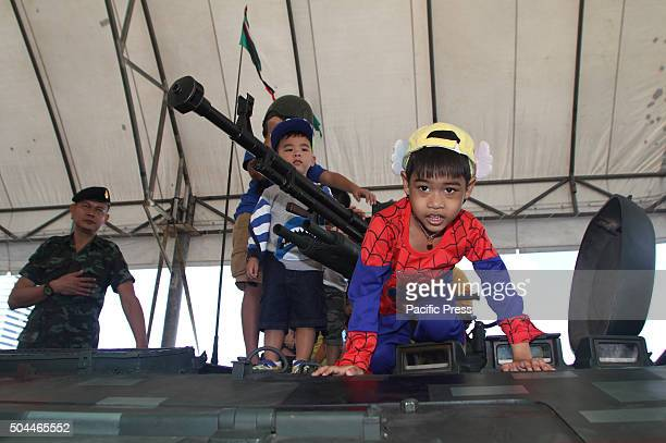 Children play on a tank during the National Children's Day at the Horse Brigade Bangkok Weapons such as tanks troop transport artillery guns...