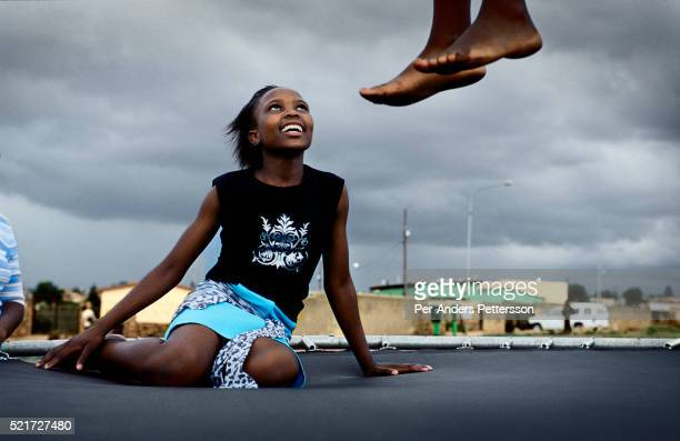Children play on a trampoline in Soweto Johannesburg South Africa Soweto is the biggest township in South Africa and has a population of about 35...