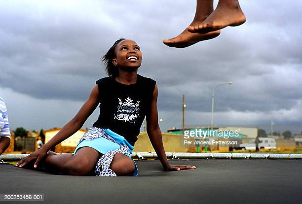 Children play on a trampoline on March 10 2005 in Soweto Johannesburg South Africa Soweto is the biggest township in South Africa and has a...