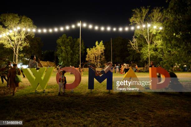 Children play on a WOMAD sign during 2019 WOMADelaide on March 09, 2019 in Adelaide, Australia.