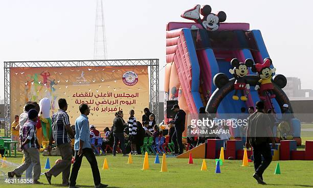 Children play on an inflatable slide during the Qatar National Sport Day in the capital Doha on February 10 2015 More than a million Qataris were...