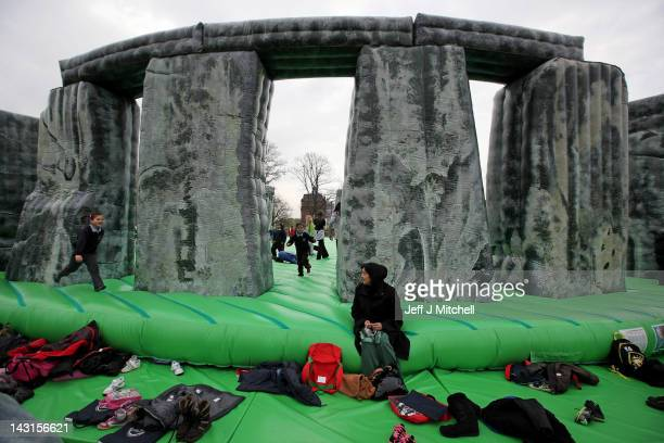 Children play on an interactive piece of artwork by Jeremy Deller Sacrilege as it is launched as part of the Glasgow International Festival of Visual...