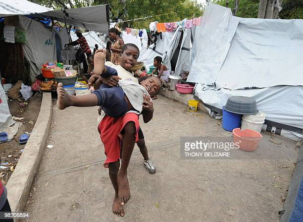 Children play on April 01 2010 in a tent city of PetionVille a neighborhood of PortauPrince The global community has pledged nearly 10 billion USD...