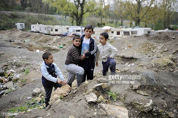 Children play on April 5 2011 in the MoulinGalant camp in CorbeilEssonnes outside Paris where about 70 Roma families live AFP PHOTO / ERIC FEFERBERG