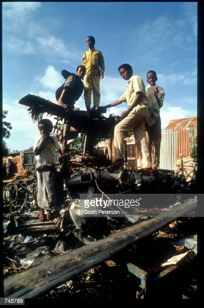 Children play on helicopter wreckage December 9 1993 in Mogadishu Somalia On October 3 Somali militiamen shot down two US Blackhawk helicopters...