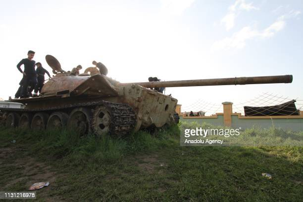 Children play on military vehicles used during the 8 years of Iran and Iraq war, at Martyrs Memorial, in Halabja, Iraq on March 16, 2019.