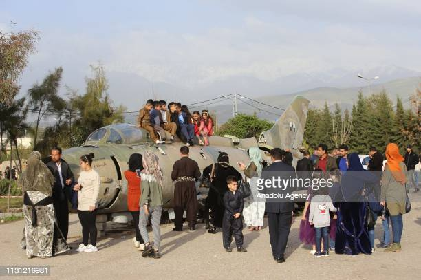 Children play on military vehicles used during the 8 years of Iran and Iraq war at Martyrs Memorial in Halabja Iraq on March 16 2019
