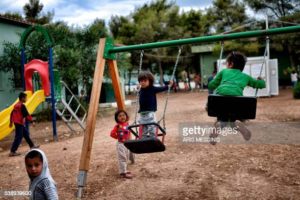 Children play on playground at the refugee camp of Schisto on June 8 2016 in Athens The Schisto camp which accomodates some 1700 migrants of all ages...