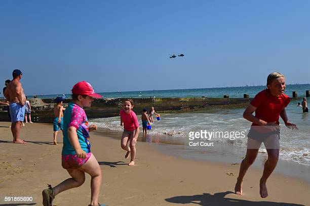 Children play on the beach during the Bournemouth Air Festival on August 18 2016 in Bournemouth England The air show runs from the 18th to 21st...