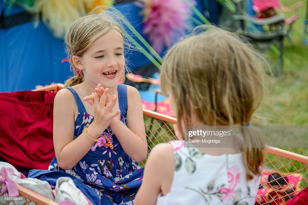Children play on the campsite on the first day of Camp Bestival at Lulworth Castle on July 31, 2014 in Wareham, United Kingdom.