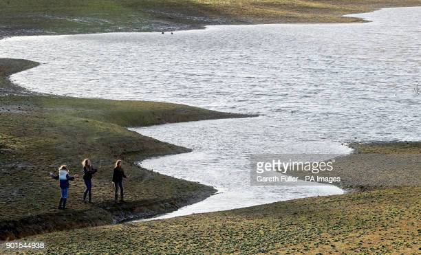 Children play on the edge of Bewl Water reservoir near Lamberhurst in Kent as Southern Water applied for a drought permit amid flood alerts and...