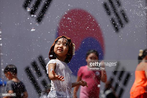Children play on the ground fountains at Seodaemun Prison the former prison used to lock Independent fighters from 1908 on August 15 2016 in Seoul...