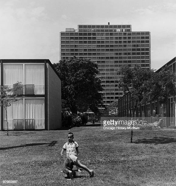 Children play on the lawn outside one of the buildings of the Lafayette Park development in Detroit MI 1974 The complex which includes high and low...