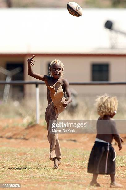 Children play on the oval before the Far North West Sports League football grand final between Amata in black and Wintjalangu in white on September...