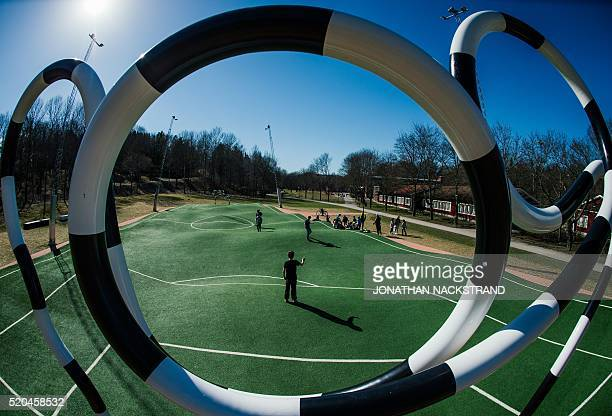 """Children play on the """"Puckelboll"""" pitch in Skaerholmen, south-west of Stockholm, on April 11, 2016. The 'Puckelboll' pitch is an artwork designed by..."""