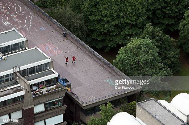 Children play on the roof of a building as seen from Cromwell Tower on the Barbican Estate on July 7 2009 in London England Many of London's famous...
