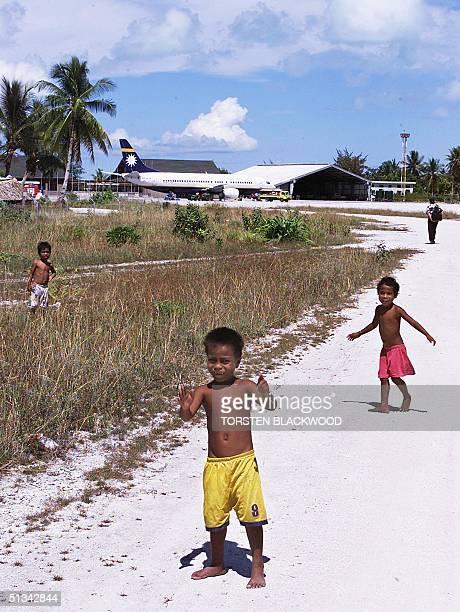 Children play on the runway of Bonriki International Airport control tower on Tarawa in the remote and farflung archipelago of Kiribati 11 September...