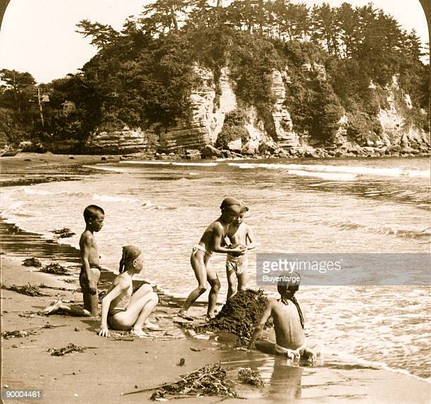 Children play on the shore of Enoshima which is a small island at the mouth of the Katase River Adjacent to the closest beach to Tokyo and Yokohama...