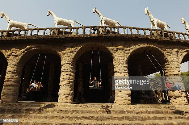 Children play on the swings at the Rock Garden on March 26 2010 in Chandigarh India The 12acre Rock Garden which began as secret project of Nek Chand...