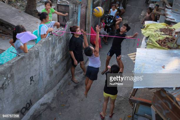 Children play on their makeshift volleyball court at a residential area in Quezon City northeast of Manila on Friday 13 April 2018 Students enjoy...