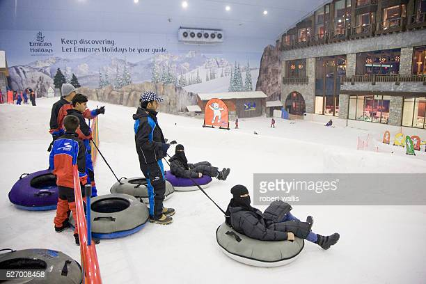 Children play on tubes at Ski Dubai at the Mall of the Emirates AlSoufouh Dubai Ski Dubai is the Middle East's first indoor ski resort with five runs...