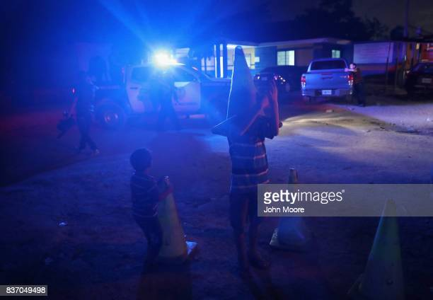 Children play outside a police station on August 16, 2017 in San Pedro Sula, Honduras. Crime and poverty have driven up immigration from Honduras to...