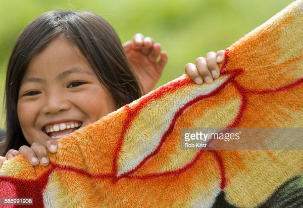 children play outside a rug shop - paro district stock pictures, royalty-free photos & images
