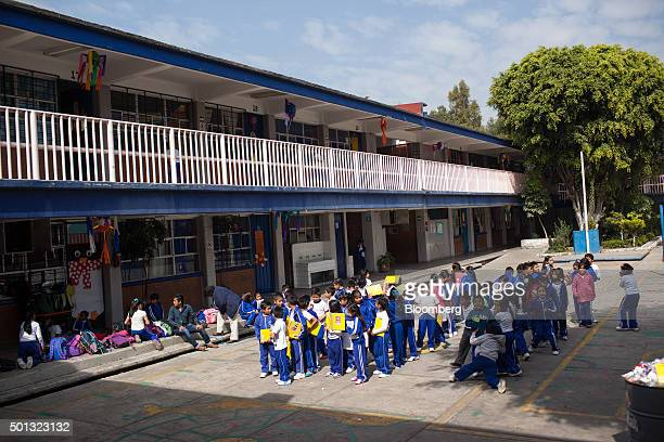 Children play outside at the Ingeniero Miguel Bernard primary school on the southern outskirts of Mexico City Mexico on Friday Dec 11 2015 To fix its...