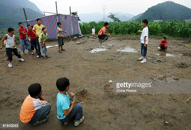 Children play outside of relief tents at the Yinghua Township on June 19, 2008 in Shifang of Sichuan Province, China. More than 69,000 people are now...