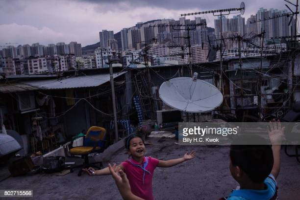 Children play outside the rooftop hut on June 3 2017 in Hong Kong Hong Kong Hong Kong is marking 20 years since the territory was handed from Britain...