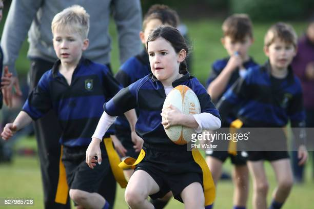 Children play rugby during an Auckland Rippa Rugby Junior Rugby match at Cox's Bay Reserve on August 5 2017 in Auckland New Zealand