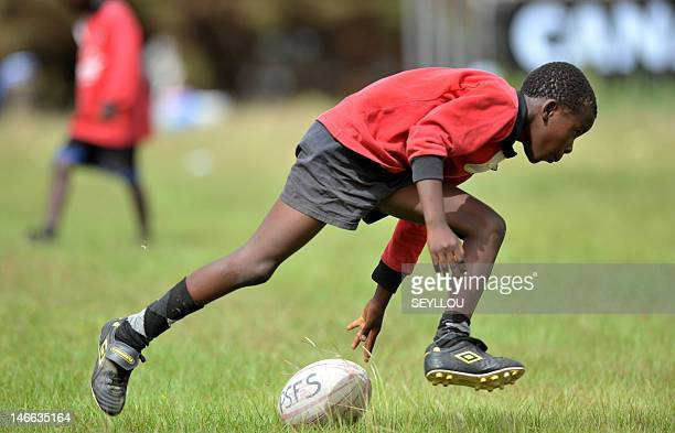Children play rugby on June 9 2012 in Dakar In Senegal rugby used to be a sport practiced by European expatriates but now more and more Senegalese...