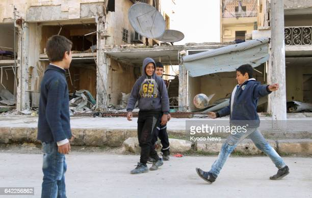Children play soccer around destroyed buildings in Aleppo Syria on Feb 10 2017 ==Kyodo