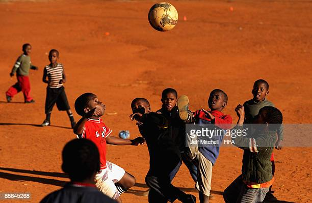 Children play soccer in Soweto township on June 23, 2009 in Johannesburg, South Africa. South Africa is currently hosting the FIFA Confederations Cup...
