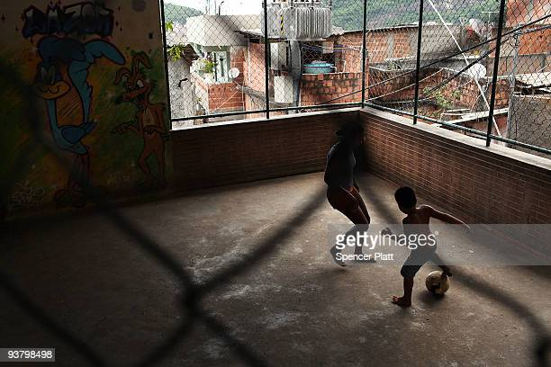 """Children play soccer in the recently """"pacified"""" Santa Marta, one of Rio's oldest slums, or favela on December 3, 2009 in Rio de Janeiro, Brazil...."""