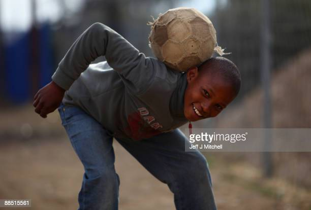 Children play soccer in the street near the Seisa Ramabodu Stadium on June16 2009 in Bloemfontein South Africa South Africa is currently hosting the...