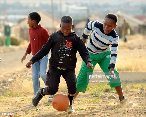 Children play soccer in the street of a township near the Seisa Ramabodu Stadium during Youth Day a national holiday on June 16 2009 in Bloemfontein...
