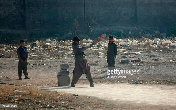 Children play street cricket outside The Rawalpindi Cricket Stadium during the England winter tour on December 18 2005 in Rawalpindi Pakistan...