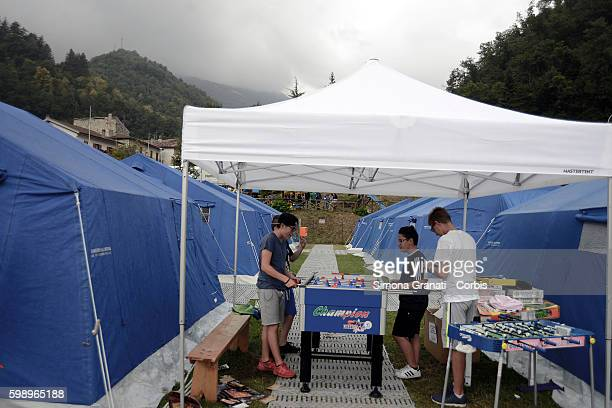 Children play table football in the tent camp erected for earthquake victims on August 31, 2016 in Arquata del Tronto, Italy. The region was struck...