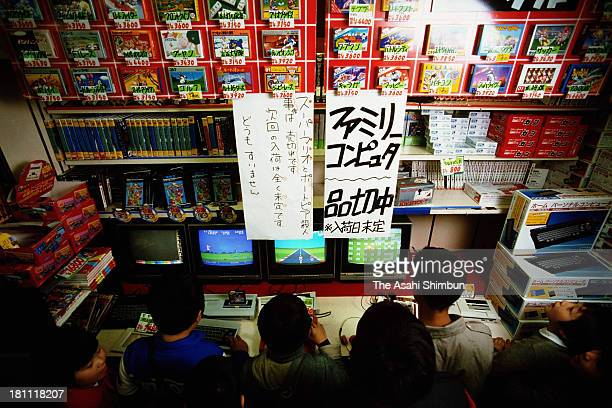 Children play the Family Computers displayed at Yodobashi Camera Shinjuku in 1986 in Tokyo Japan The sales of video game console launched in 1983...