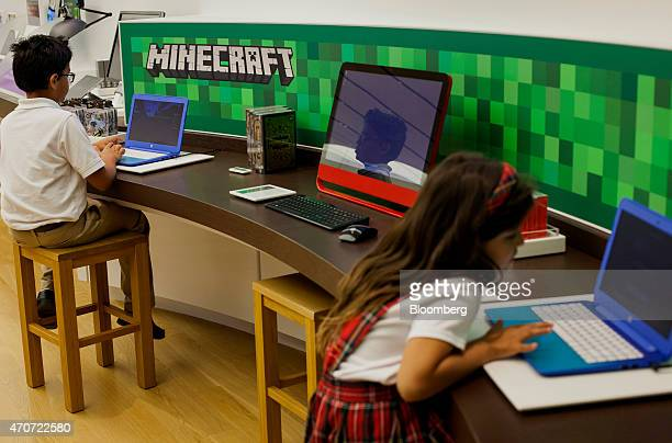 Children play the Minecraft video game at a Microsoft Corp store in Bellevue Washington US on Tuesday April 21 2015 Microsoft Corp is scheduled to...