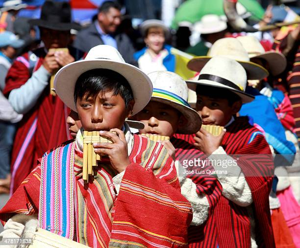 Children play the panpipe during celebration of the AndeanAmazonic New Year 5523 on June 21 2015 in El Alto La Paz Bolivia