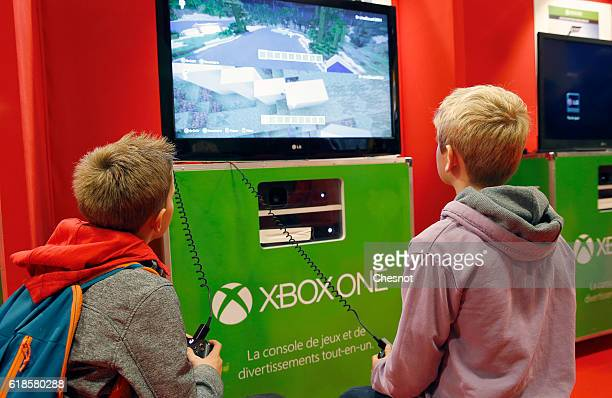 Children play the video game 'Minecraft' on Microsoft Xbox One console during the 'Paris Games Week'on October 27 2016 in Paris France 'Paris Games...