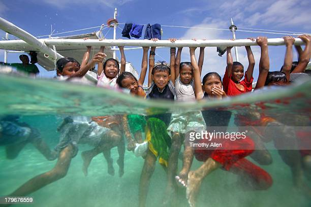 Children play underwater on a tropical island