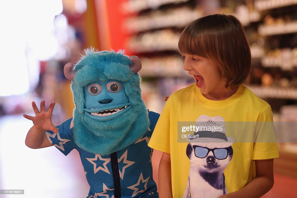 Children play with a 'Sulley Monster Mask' in Hamleys toy shop on June 27, 2013 in London, England. The mask, which retails for 40 GBP, is included in Hamleys' predictions for the top selling toys for Christmas 2013.