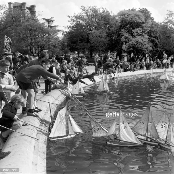 Children play with boats at the Tuileries garden on May 1964 in Paris AFP PHOTO