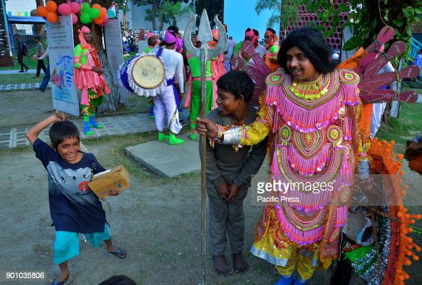 Children play with Chhau Dancer during a programe in Kolkata Artist from Purulia performing Chhau Dance a mythological act during a program