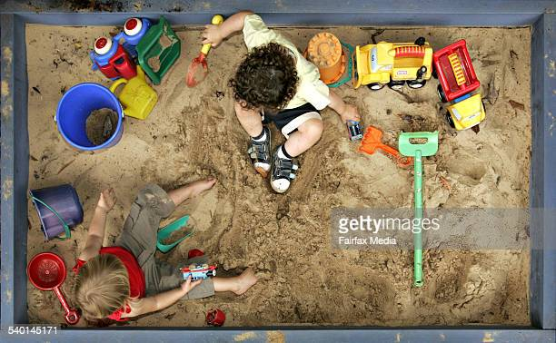 Children play with colourful toys in a sandbox 10 January 2007 AFR Picture by PHIL CARRICK
